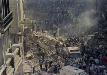 Rescue workers pick through the debris of Israel's Embassy after a bombing in Buenos Aires, Argentina, in 1992. The attack, which killed 29, has never been solved. NPR's Jasmine Garsd, who was 9 at the time, was just down the block.