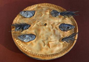 Stargazy Pie, a Cornish dish named for the way the fish heads poke through the crust toward the sky.
