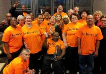 The Dallas Street Choir performed in T-shirts, then changed into formalwear for the <em>Street Requiem</em>. Baritone Russell Rodriguez is in front, far right, in an orange T-shirt.