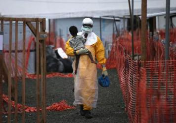 Dr. Cedric Yoshimoto of Volcano, Hawaii, and Dr. Citlali Barba of Mexico City cared for both Edwin Koryan and his granddaughter Komasa at the Ebola treatment center run by Doctors Without Borders in Foya, Liberia.