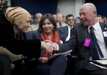 Hedieh Mirahmadi (from left) of the World Organization for Resource Development and Education; Paris Mayor Anne Hidalgo; and Vilvoorde, Belgium, Mayor Hans Bonte greet each other at the White House Summit on Countering Violent Extremism.