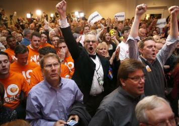Supporters cheer in Colorado Springs, Colo., as a television broadcast declares that Republicans have taken control of the Senate. Republican candidates, party committees and outside groups spent about $44 million more than Democrats, according to the Ce