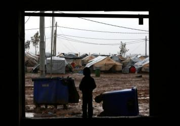 An Iraqi child who fled fighting between the so-called Islamic State and Kurdish peshmerga is among the some 3,000 people living at the Baharka camp, near Irbil, the capital of the Kurdish autonomous region in northern Iraq, on Jan. 16.