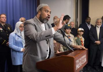 Mohamed Magid, imam with the All Dulles Area Muslim Society, speaks during in September during an anti-extremism news conference. He says that if someone with dangerous views comes to his mosque, he first tries to correct them, but reports them to authorities if necessary.