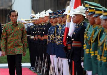 Protesters rally in front of the presidential palace in Jakarta on Jan. 28. Indonesia's new President Joko Widodo has won praise for economic reforms, but critics say he has not yet followed through on pledges to improve human rights and battle corruptio