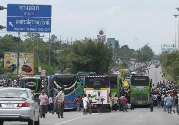 A rural highway in southern Thailand photographed in 2013. Congestion and reckless driving are not uncommon on the country's roads and thoroughfares.