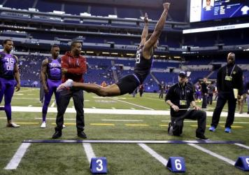 University of Connecticut defensive back Byron Jones takes off for the broad jump at the NFL combine Monday. Jones recorded an NFL record of 12 feet 3 inches.