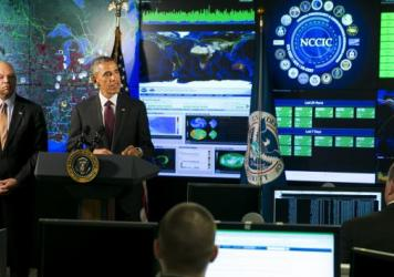 President Obama, joined by Homeland Security Secretary Jeh Johnson (left), delivers remarks at the National Cybersecurity and Communications Integration Center on Jan. 13 in Arlington, Va. Obama discussed efforts to improve the government's ability to co