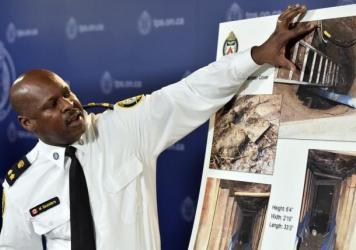 Deputy Chief Mark Saunders speaks at a news conference in Toronto on Tuesday. A mysterious tunnel discovered in Toronto near one of the venues for this summer's Pan American Games contained a rosary with a crucifix and poppy. Police said there is nothing