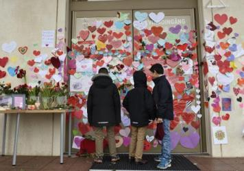 Boys in Uppsala, Sweden, read supportive messages placed at the entrance of a mosque following an attack in January. A new Pew study finds that religious intolerance is a global problem, with Muslims facing more hostility from individuals, and Christians