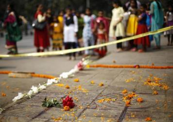 People gather on the spot where Bangladeshi blogger Avijit Roy was killed in Dhaka, Bangladesh, on Thursday.