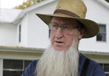 Sam Mullet stands in the front yard of his home in Bergholz, Ohio, in 2011. Mullet has now been sentenced to serve 10 years and nine months in jail.