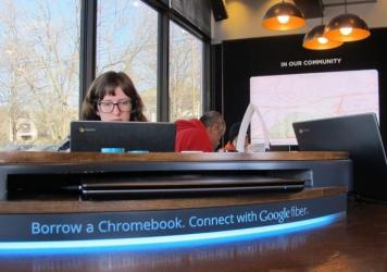 An AT&T worker splices cable for the suburb of Overland Park. Last month, the company became the third provider broadly offering affordable gibabit Internet to residents.