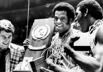 Indiana coach Bobby Knight and his players Scott May and Quinn Buckner celebrate the championship win that capped their undefeated season in 1975-76. No team has matched the feat in the decades since.