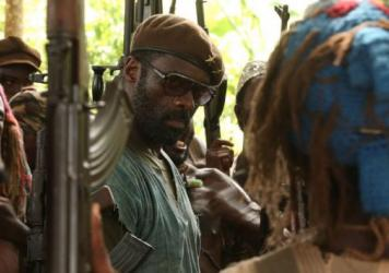 Idris Elba stars as an African warlord in the forthcoming film <em>Beasts of No Nation</em>. Netflix recently purchased distribution rights for the film for nearly $12 million.