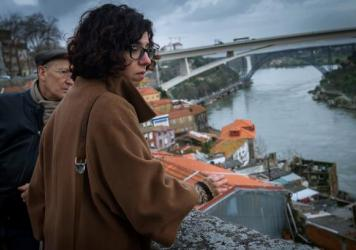 Portuguese architect Margarida Castro (right) provides a tour of  Porto in 2014. She is one of three unemployed architects who set up Worst Tours to show visitors the poverty in the city, which has been hard hit by the country's weak economy in recent years.