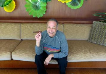 Sam Simon, co-creator of <em>The Simpsons</em>, shown here in 2013 at his home in Pacific Palisades, Calif., died Sunday at 59.