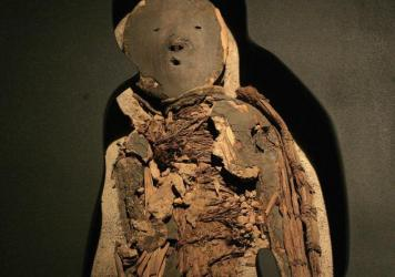 A mummy of a Chinchorro child, dating to between 5000 B.C. and 3000 B.C. The Chinchorros were hunter-gatherers who lived in the region between modern-day Peru and Chile.