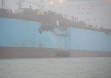 The chemical tanker Carla Maersk sits at anchor off Morgans Point, Texas, after Monday's collision in foggy weather. The Maersk was carrying about 216,000 barrels of the gas additive MTBE.