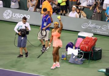World No. 1 Serena Williams acknowledges the crowd after winning her match against Monica Niculescu of Romania during the BNP Paribas Open at Indian Wells Tennis Garden in Indian Wells, Calif.
