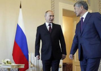 Russian President Vladimir Putin and his Kyrgyz counterpart, Almazbek Atambayev, arrive for a meeting Monday at the Constantine Palace in St. Petersburg, Russia.