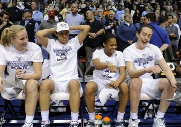 Members of Connecticut's women's basketball team react after their 84-70 victory over USF in an NCAA college basketball game in the finals of the American Athletic Conference tournament. UConn is the returning champ in this year's women's bracket. (AP Ph