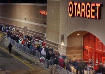 Shoppers line up outside a Target store in South Portland, Maine.