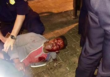 Martese Johnson is held down by an officer Wednesday in Charlottesville, Va., in this photo provided by Bryan Beaubrun.