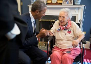 President Obama and Vice President Biden visit with Lucy Coffey in the Vice President's Office of the White House on July 25, 2014.