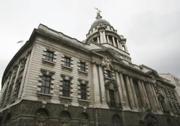 A statue of the scales of justice stands above the Old Bailey, the courthouse where many high-profile libel cases are tried, in London. The U.K. is a popular place for libel cases to be filed because of laws that make it difficult for journalists or the media to prevail.