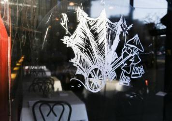 The logo of Chop Chop Chinaman restaurant sits on a window outside the dinning area Thursday in Chicago.