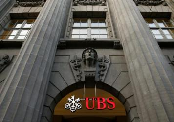 The logo of Swiss bank UBS is seen at the company's headquarters in Zurich. U.S. officials are investigating UBS and Barclays for manipulating currency rates at a time when they were already operating under a deferred prosecution agreement for manipulati