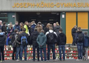 Students mourn in front of their school in Haltern, Germany, on Wednesday, a day after the Germanwings plane crash. Sixteen high-schoolers and two teachers from the school were among the 150 people onboard the plane.
