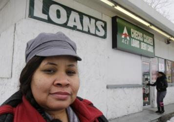 Maranda Brooks stands in January outside a payday loans business that she used to frequent. Troubled by consumer complaints and loopholes in state laws, federal regulators are proposing expansive, first-ever rules on payday lenders, aimed at helping cash