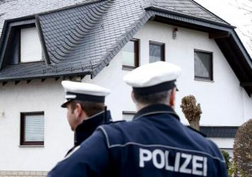 German policemen stand outside a house believed to belong to Andreas Lubitz in Montabaur, Germany, on Thursday. Lubitz, the co-pilot on the Germanwings plane that crashed Tuesday, is suspected of deliberately crashing a the jet into the French Alps.