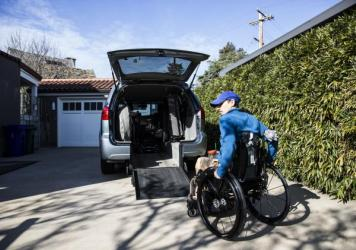 Frances Stevens uses a custom ramp leading to her van. An accident at work 17 years ago left her unable to walk. She received full workers' compensation benefits until two years ago when the insurer suddenly withdrew her medications and home health aide. Her lawsuit is a test of the state's use of anonymous independent medical reviewers.