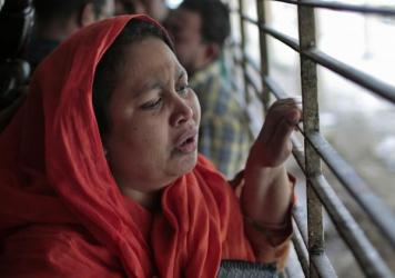 Shilpi, a cousin of Bangladeshi blogger Washiqur Rahman, is seen outside a morgue at the Dhaka Medical College in Dhaka, Bangladesh, on Monday. The blogger was hacked to death this morning by three men in the capital, police said.