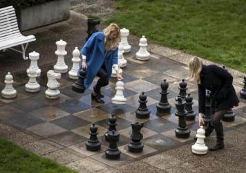 Prolonged nuclear talks gave Russian journalists time to play a game of giant chess Wednesday in a courtyard of the Beau-Rivage Palace Hotel in Lausanne, Switzerland.