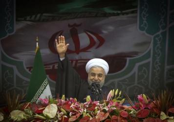 Iran's President Hassan Rouhani, speaking in Tehran in February, has spoken out in favor of nuclear negotiations and opening Iran to the world. But he has faced criticism from hard-liners at home.