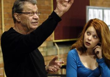 Critic and opera translator Andrew Porter directs singer Nikki Einfeld during a rehearsal of a Canadian Opera Company production of Mozart's <em>Magic Flute</em> in Toronto in 2005.