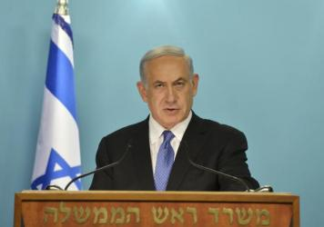 "A photo released by Government Press Office shows Israeli Prime Minister Benjamin Netanyahu as he delivers a statement on April 3 ""strongly opposing"" the framework deal."