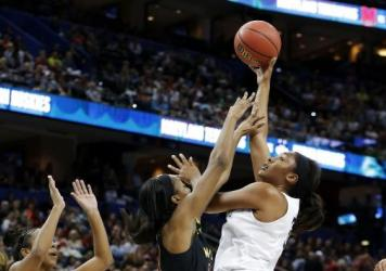 Morgan Tuck of the Connecticut Huskies shoots against Shatori Walker-Kimbrough of the Maryland Terrapins during the NCAA Women's Final Four Semifinal in Tampa, Fla.