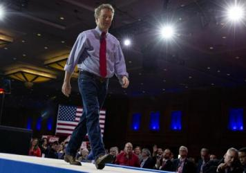 Supporters of Sen. Rand Paul cheer as he speaks during CPAC.