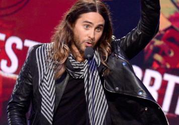 The producers of <em>Dallas Buyers Club</em> want to contact people who have viewed pirated copies of the film. Here, actor Jared Leto accepts an award for his work in the film at the 2014 Film Independent Spirit Awards.