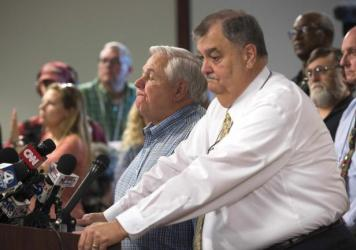 North Charleston Mayor R. Keith Summey, left, and Police Chief Eddie Driggers spoke Wednesday about a video that shows a white police officer fatally shot a fleeing black man after a traffic stop.
