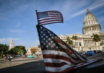 U.S. flags are seen in a bici-taxi near the capitol in Havana in January.