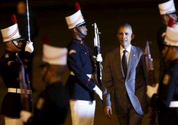 President Barack Obama walks past an honor guard after arriving in Panama City Thursday. Obama is attending the Summit of the Americas, where he's expected to meet Cuba's President Raul Castro.