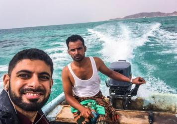 """A """"getaway selfie,"""" as Mokhtar Alkhanshali calls it: Alkhanshali (left) makes his way across the Red Sea with this boat driver — and without navigation equipment."""