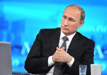 Russian President Vladimir Putin listens during an annual call-in show on Russian television in Moscow on Thursday.
