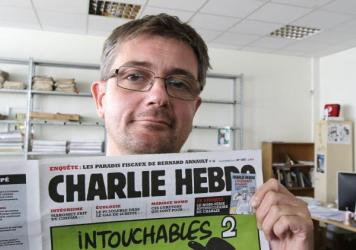 """Stephane """"Charb"""" Charbonnier, editor of <em>Charlie Hebdo</em>, is seen on Sept.19, 2012. The late editor takes on politicians, the media and """"Islamophobia"""" in a posthumously published book completed two days before he was killed Jan. 7."""
